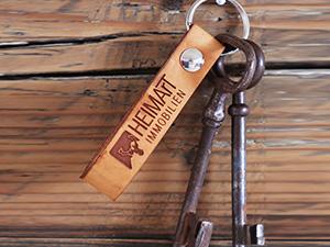 Schlüssel mit HEIMArT Immobilien Schlüsselanhänger