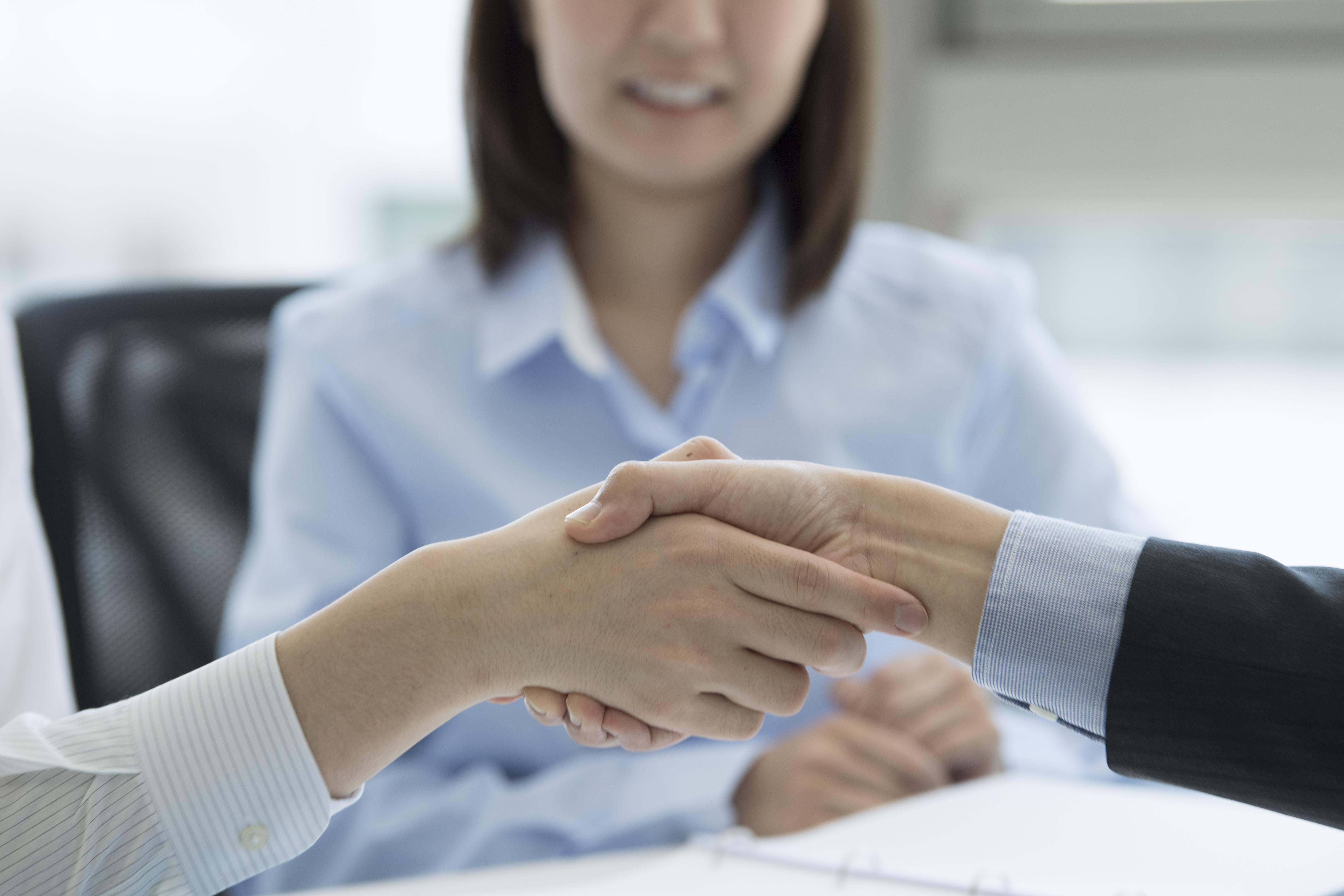 Einigung durch Händeschütteln