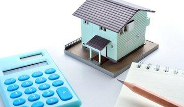 Miniatur Berechnung der Kosten einer Immobilie